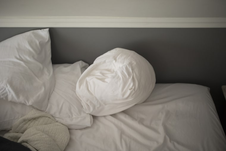 Image: An unmade bed