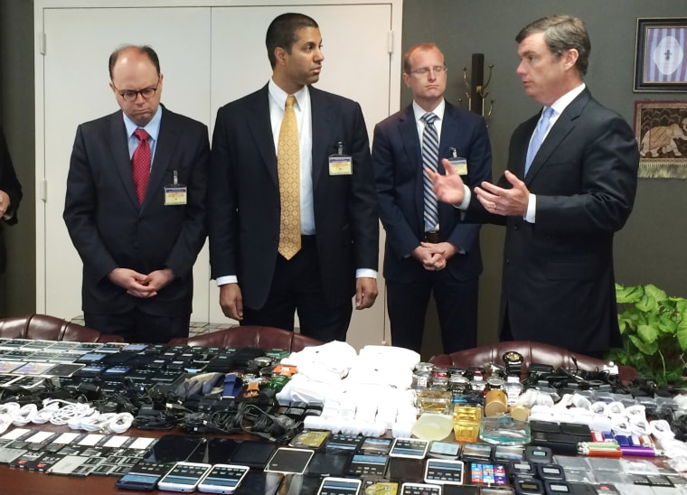 Image: Hundreds of cellphones are displayed after they were seized in a raid from the Lee Correctional Institution, S.C.
