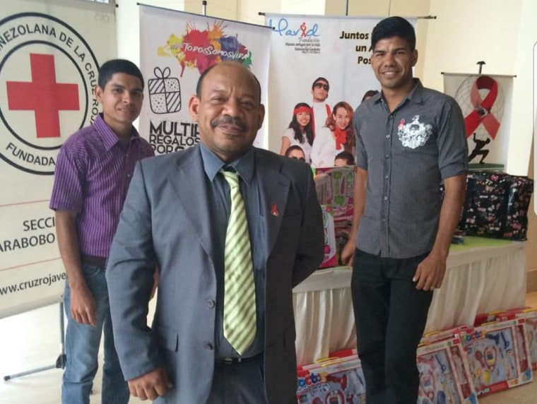 Eduardo Franco (center) at an event providing information about his HIV/AIDS organization, MAVID, which is based in Carabobo, Venezuela.