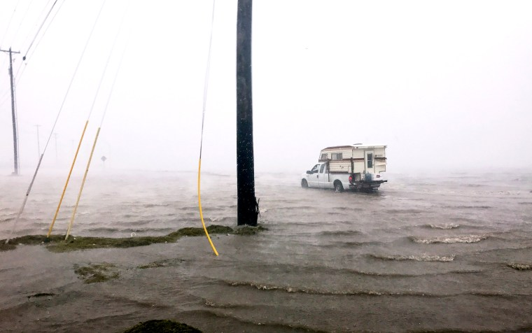 "Image: Craig ""Cajun"" Uggen, 57, nearly floods his truck as Hurricane Harvey comes ashore in Corpus Christi"