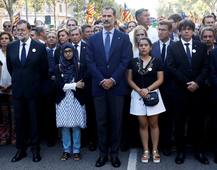 Image: Spain's King Felipe, PM Rajoy and Catalan Regional President Puigdemonttake