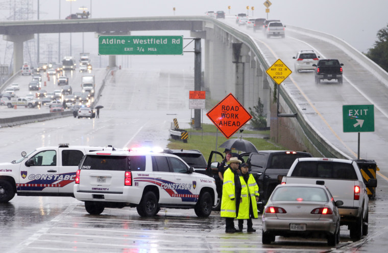 Image: Law enforcement diverts traffic off of the both directions of the 8 beltway at the Hardy Toll Road as major flooding hits Houston,