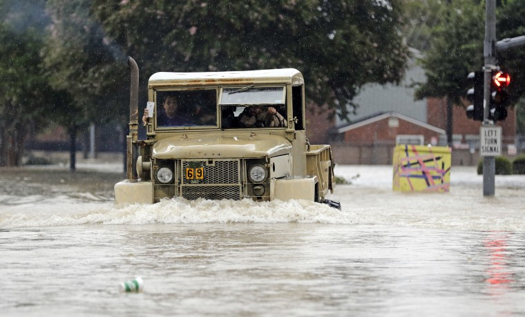 Image: A truck pushes through floodwaters