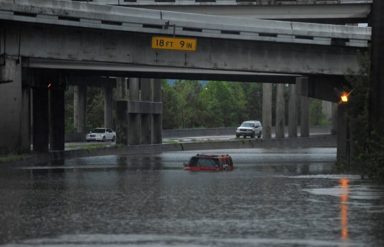 Image: An abandoned Hummer is covered in floodwaters on Interstate 610 after Hurricane Harvey inundated the Texas Gulf coast with rain, in Houston