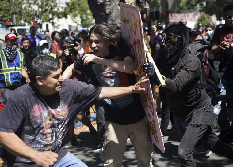 Image: Image: Demonstrators clash during a free speech rally in Berkeley