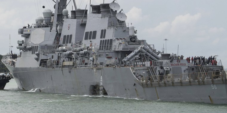 The USS John S. McCain steers towards Changi Naval Base, Singapore, on Aug. 21 after a collision with a merchant vessel off Singapore.