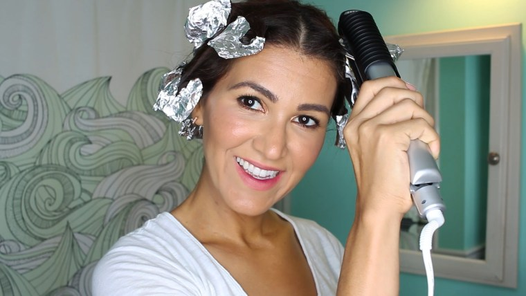 Clamp flat iron down on foil to steam hair into bouncy curls.