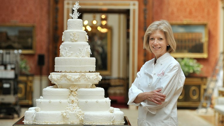 Fiona Cairns stands next to the Royal Wedding cake