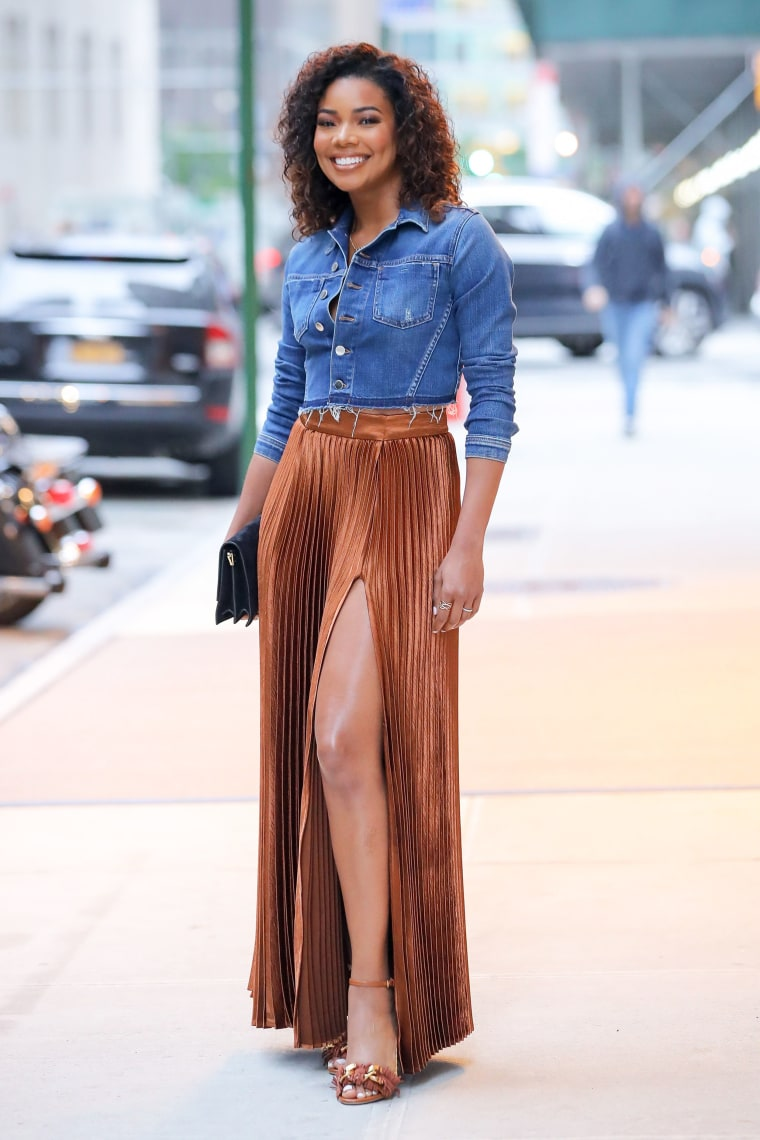 EXCLUSIVE: Gabrielle Union is spotted wearing Rust colored Thigh high split skirt with denim button up shirt in New York City
