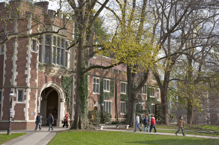 Image: Students walking to classes near building in the Collegiate Gothic style, Princeton University, Princeton, New Jersey.