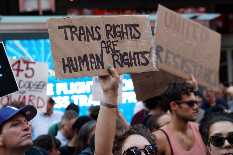 Image: FILE PHOTO: People protest Trump's announcement that he plans to reinstate a ban on transgender individuals from serving in any capacity in the U.S. military, in Times Square