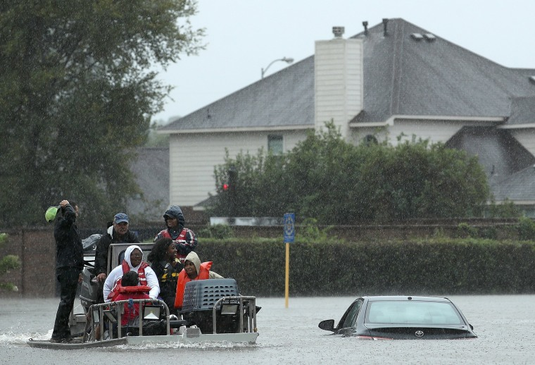 Image: Residents are evacuated from their homes after severe flooding