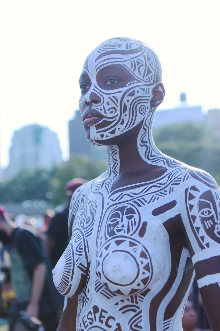 Image: Model Folasade is covered in art from Nigerian artist Laolu at AFROPUNK
