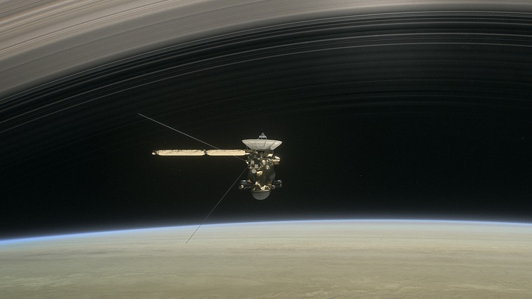 Image: In a still from the short film Cassini's Grand Finale, an artist's rendering shows the spacecraft diving between Saturn and the planet's innermost ring.