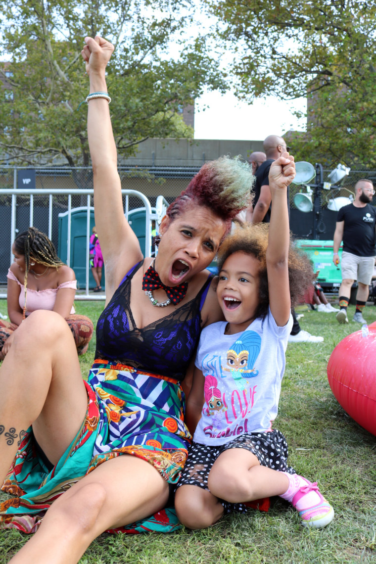 Image: Staceyann Chin and her daughter Zuri at Afropunk Festival