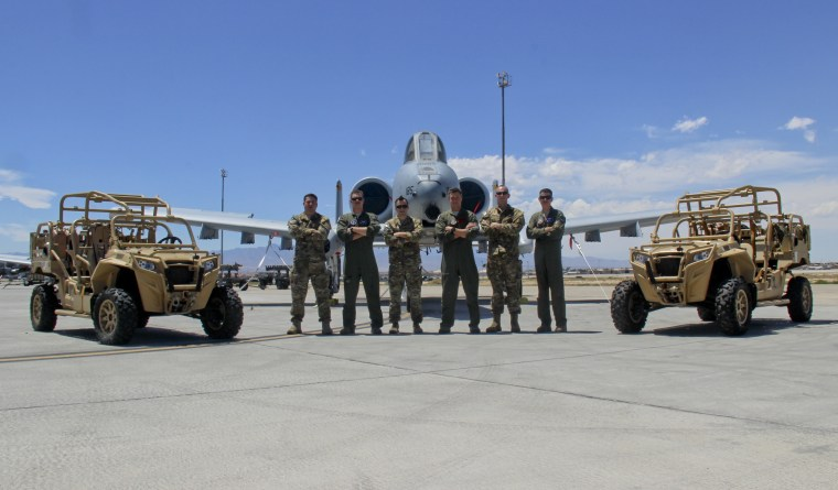66th Weapons Squadron's Officer and enlisted graduates pose for a photo.
