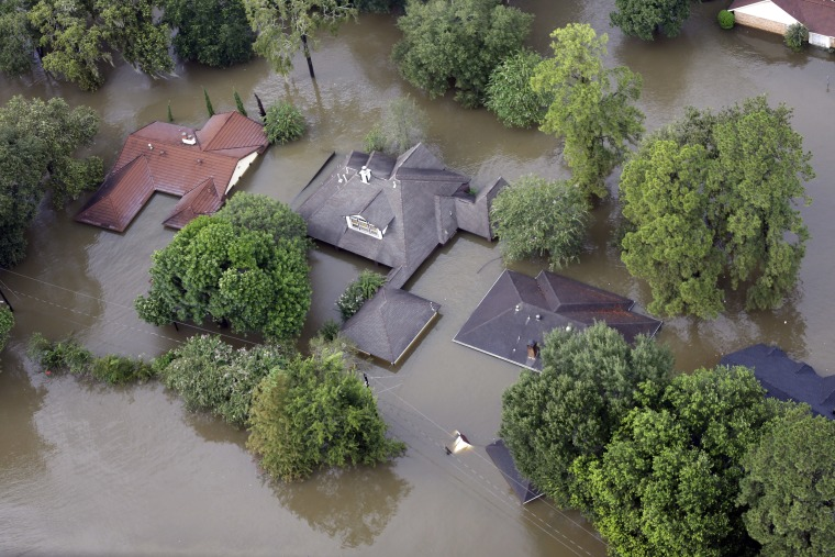Image: Homes are surrounded by floodwaters from Tropical Storm Harvey