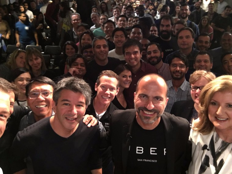 From left, Uber founder Travis Kalanick poses with Dara Khosrowshahi and Arianna Huffington.