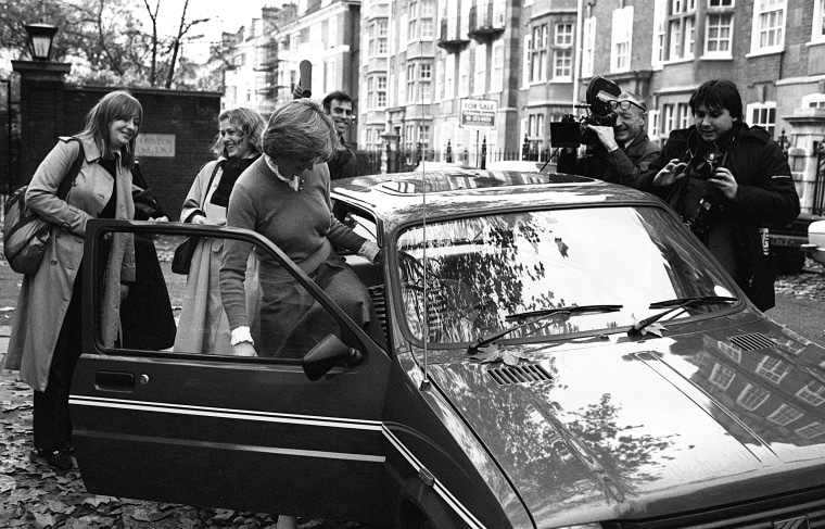 Image: Princess Diana surrounded by the media