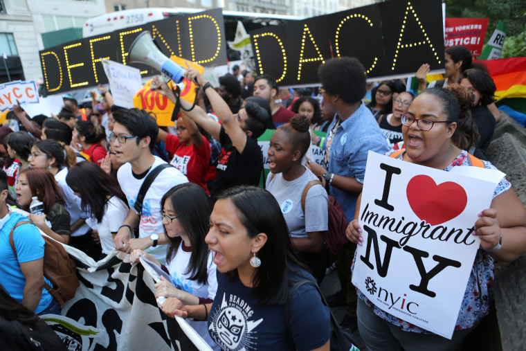 Image: People march and chant slogans against U.S. President Donald Trump's proposed end of the DACA program that protects immigrant children from deportation at a protest in New York City