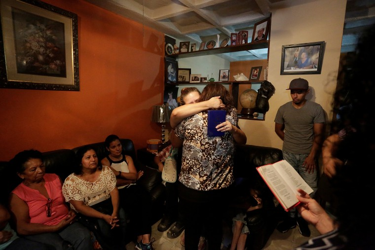 Image: Relatives of the Saldivar family, whose van was reportedly carrying six family members when it was swept away by floodwaters from Hurricane Harvey, comfort each other at their house in Monterrey