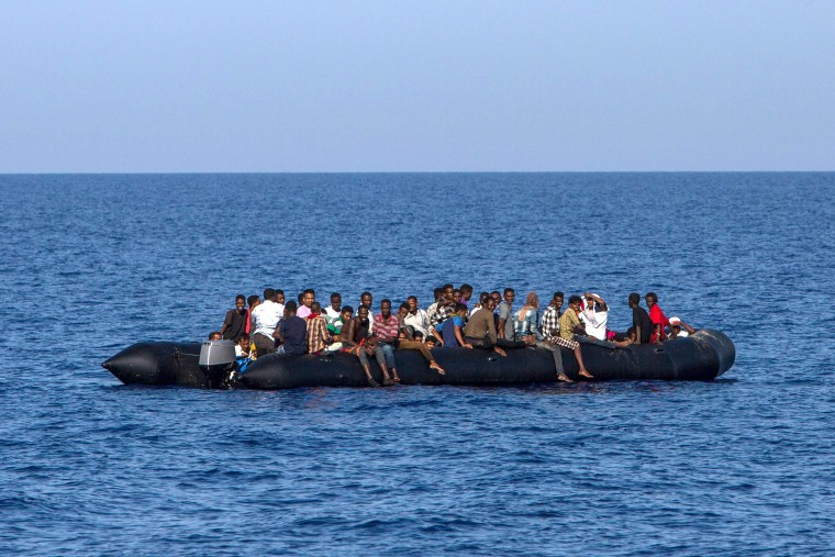 Image: Migrants await rescue off Libya's coast on Aug. 6, 2017