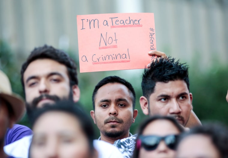 Image: Milton Flores, a Deferred Action for Childhood Arrivals (DACA) program recipient stands with supporters during a rally outside the Federal Building in Los Angeles