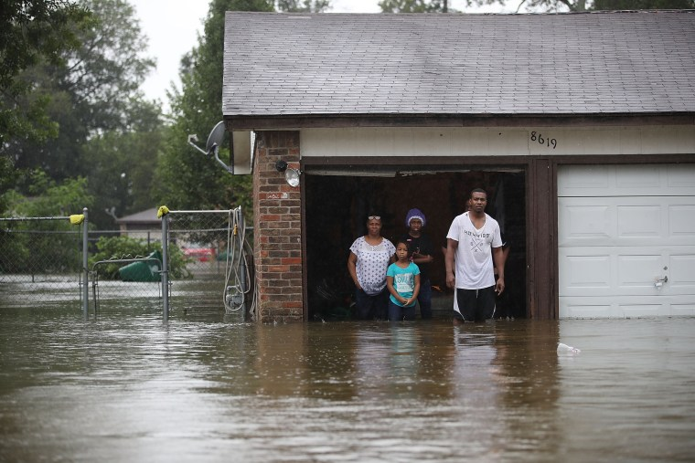 Image: People wait to be rescued from their flooded homes after their neighborhood was inundated with rain