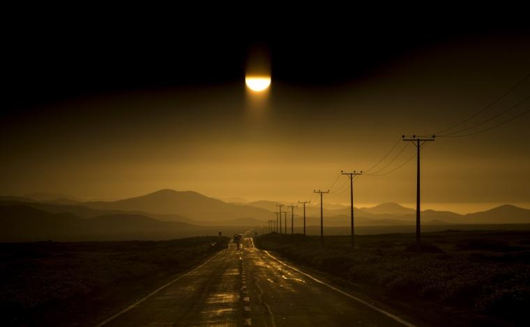 Image: A road stretches along the Atacama desert in Chile's Huasco region