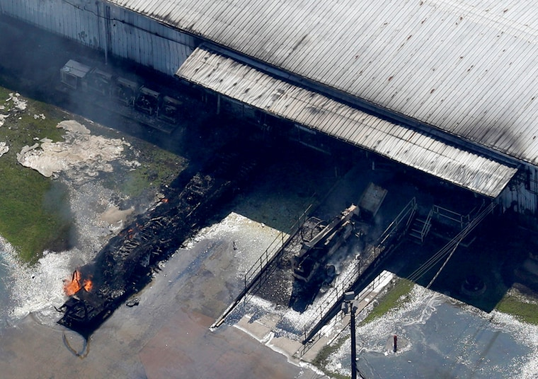 Image: A fire burns at the flooded plant of French chemical maker Arkema SA after Tropical Storm Harvey passed in Crosby