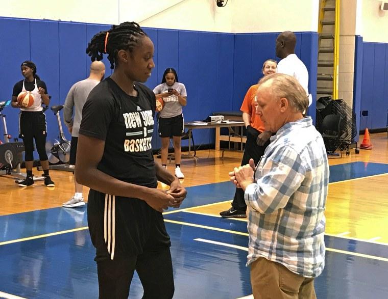 Image: New York Liberty WNBA basketball player Tina Charles talks with Dan Carlson