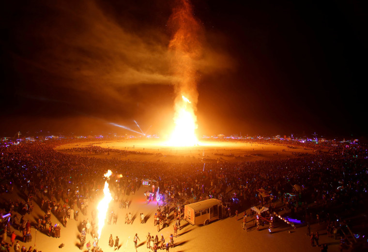 Image: The Man is engulfed in flames as approximately 70,000 people from all over the world gathered for the annual Burning Man arts and music festival in the Black Rock Desert of Nevada
