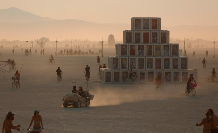 Image: Participants travel across the playa as approximately 70,000 people from all over the world gathered for the annual Burning Man arts and music festival in the Black Rock Desert of Nevada