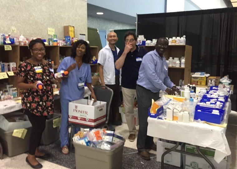 Enock Anassi is a pharmacist who has been volunteering his time assisting Harvey evacuees at NRG Stadium.