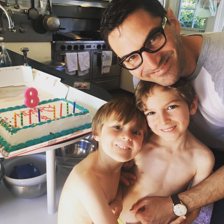 Guy Raz with his sons, Henry, 8, and Bram, 6.