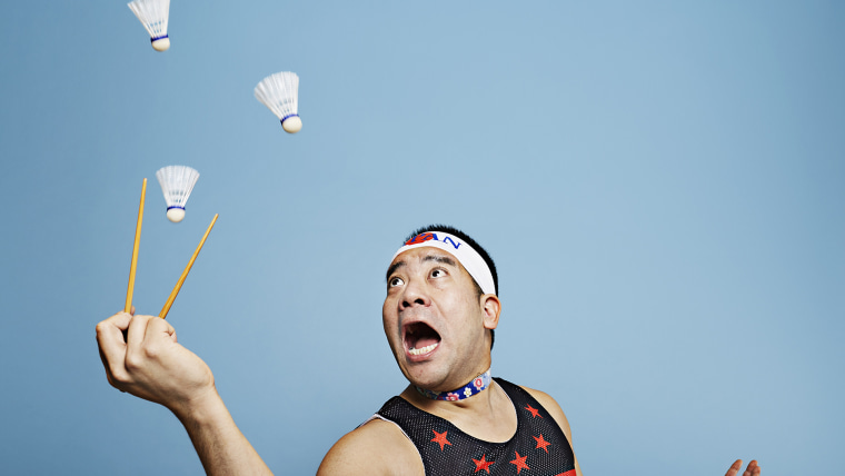 Mr Cherry - Most shuttlecocks caught with chopsticks in one minute Guinness World Records 2016 Photo Credit: Ranald Mackechnie/Guinness World Records