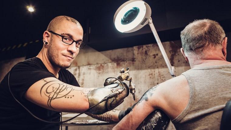 Gonzal & JC Sheitan - First Prosthetic Tattoo Arm Guinness World Records 2016 Photo Credit: Olivier Ramonteu/Guinness World Records Pictured: tattoo artist JC Sheitan