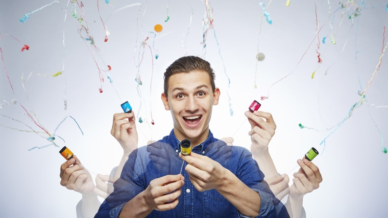 Andre Ortolf_Most Party poppers popped in a minute Guinness World Records 2016 Photo Credit: Paul Michael Hughes/Guinness World Records