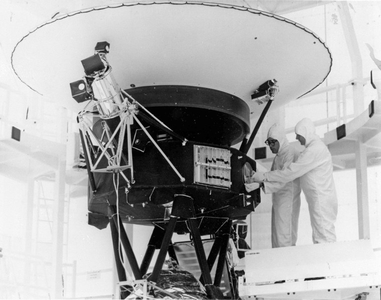 """The \""""Sounds of Earth\"""" record is mounted on the Voyager 2 spacecraft at the Kennedy Space Center on Aug. 4, 1977."""