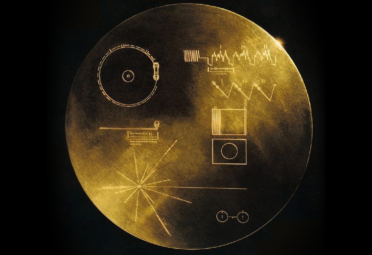 """The """"Golden Record"""" carried by Voyager was a 12-inch gold-plated copper disk containing sounds and images selected to portray the diversity of life and culture on Earth."""