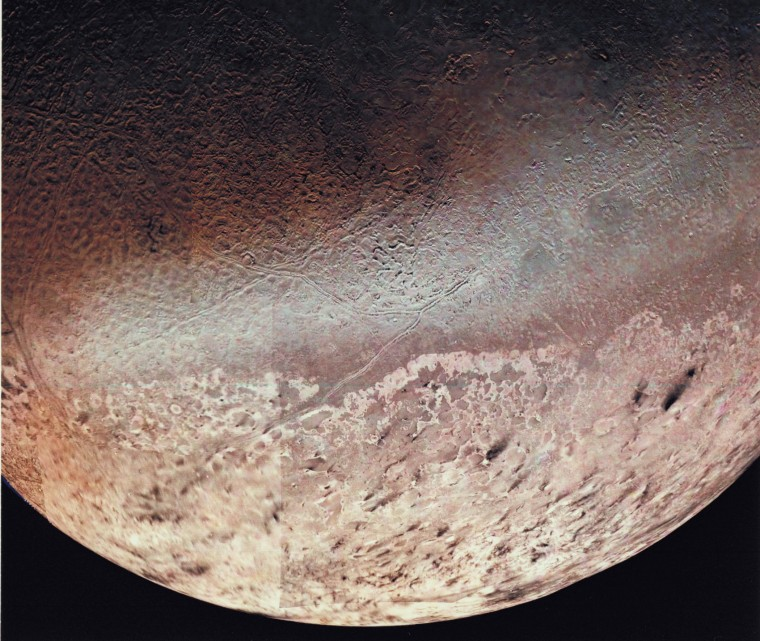 P-34764 Voyager 2 obtained this high resolution color image of Neptune's large satellite Triton during its close flyby. Approximately a dozen individual images were combined to produce this comprehensive view of the Neptune-facing hemisphere of Triton. Fine detail is provided by high resolution, clear-filter images, with color information added from lower resolution frames. The large south polar cap at the bottom of the image is highly refective and slightly pink in color , and may consist of a slowly evaporating layer of nitrogen ice deposited during the previous winter. From the ragged edge of the polar cap northward the satellite's face is generously darker and redder in color. This coloring may be produced by the action of ultraviolet light and magnetospheric radiation upon methane in the atmosphere and surface. Running across this darker region , approximately parallel to the edge of the polar cap, is a band of brighter white material that is almost bluish in color. The underlying topography in this bright band is similiar, however to that in the darker, redder regions surrounding it.