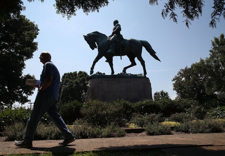 Image: The statue of Confederate Gen. Robert E. Lee stands in a park in Charlottesville
