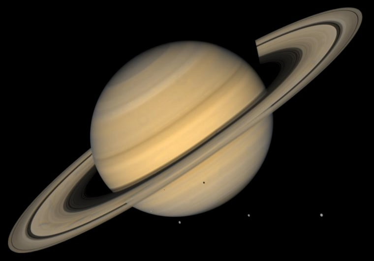 This approximate natural-color image shows Saturn, its rings, and four of its icy satellites. Three satellites (Tethys, Dione, and Rhea) are visible against the darkness of space, and another smaller satellite (Mimas) is visible against Saturn's cloud tops very near the left horizon and just below the rings. The dark shadows of Mimas and Tethys are also visible on Saturn's cloud tops, and the shadow of Saturn is seen across part of the rings. Saturn, second in size only to Jupiter in our Solar System, is 120,660 km (75,000 mi) in diameter at its equator (the ring plane) but, because of its rapid spin, Saturn is 10% smaller measured through its poles. Saturn's rings are composed mostly of ice particles ranging from microscopic dust to boulders in size. These particles orbit Saturn in a vast disk that is a mere 100 meters (330 feet) or so thick. The rings' thinness contrasts with their huge diameter--for instance 272,400 km (169,000 mi) for the outer part of the bright A ring, the outermost ring visible here. The pronounced concentric gap in the rings, the Cassini Division (named after its discoverer), is a 3500-km wide region (2200 mi, almost the width of the United States) that is much less populated with ring particles than the brighter B and A rings to either side of the gap. The rings also show some enigmatic radial structure ('spokes'), particularly at left. This image was synthesized from images taken in Voyager's blue and violet filters and was processed to recreate an approximately natural color and contrast. http://photojournal.jpl.nasa.gov/catalog/PIA00400