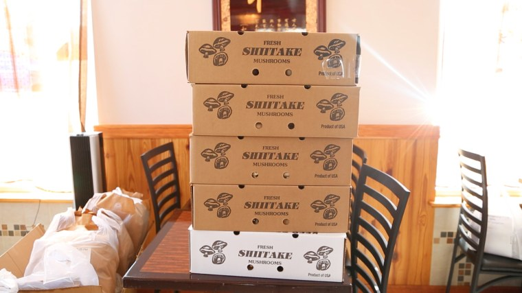 Boxes of shiitake mushrooms purchased through a WeChat buying group in East Asian Fusion restaurant in New Jersey.