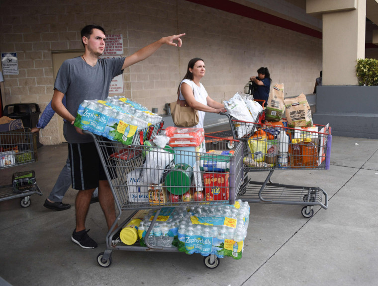 Image: Shoppers at Costco waited up to eight hours for water and essentials