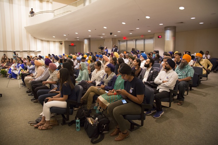 Members of Fresno's Sikh community look on as the city council votes to rename a park after Jaswant Singh Khalra, a Sikh human rights activist who was killed in 1995 by police officers in India.