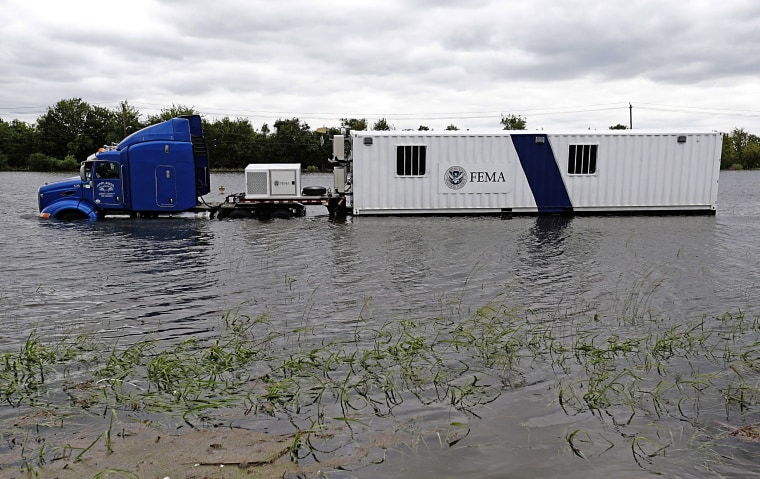 Image: A FEMA truck sits in floodwaters on the Beltway 8 feeder road