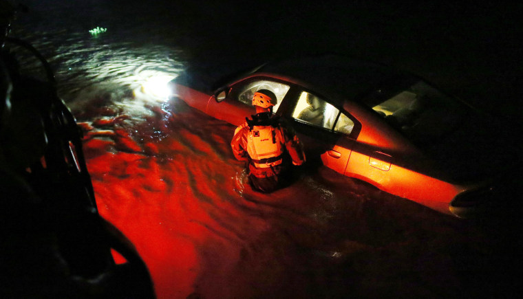 Image: A rescue team inspects flooded areas after Hurricane Irma
