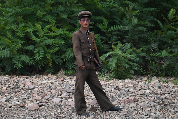 Image: A North Korean soldier stands on the bank of the Yalu river near the North Korean town of Sinuiju