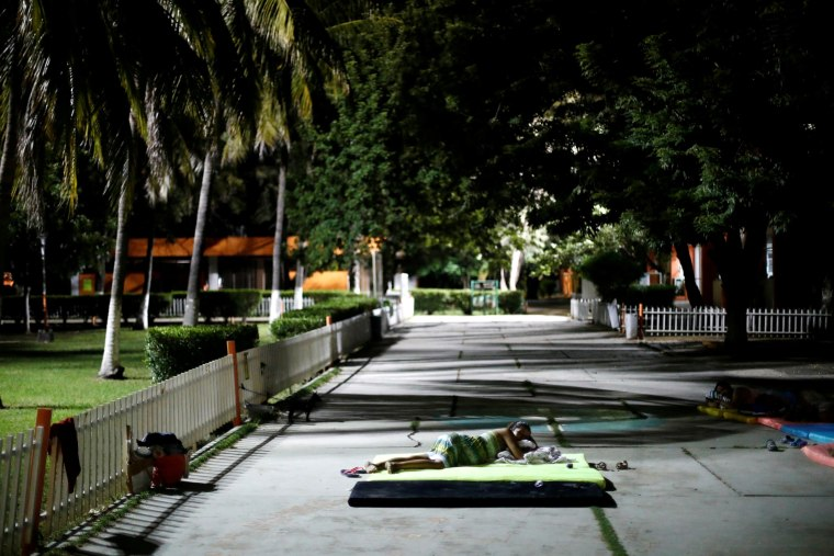 Image: A resident sleeps outside after an earthquake struck off the southern coast of Mexico.